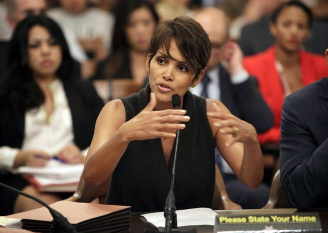 Actress Halle Berry testifies June 25, 2013, before the Assembly Committee on Public Safety at the Capitol in Sacramento, Calif., for a bill that would limit the ability of paparazzi to photograph children of celebrities and public figures. (Associated Press)