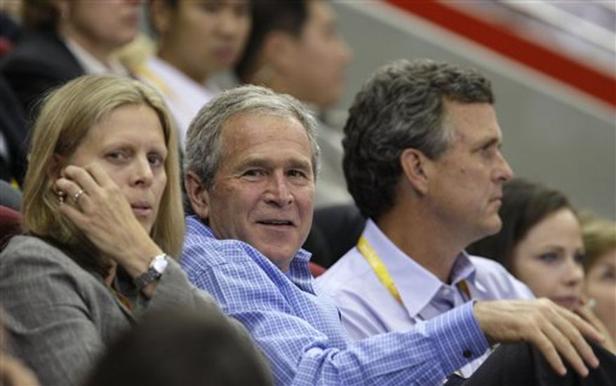 **FILE** USA Basketball president Val Ackerman, left, is joined by U.S. President George Bush at the USA vs Czech Republic women's preliminary basketball game at the Beijing 2008 Olympics in Beijing, Saturday, Aug. 9, 2008. (AP Photo/Eric Gay)