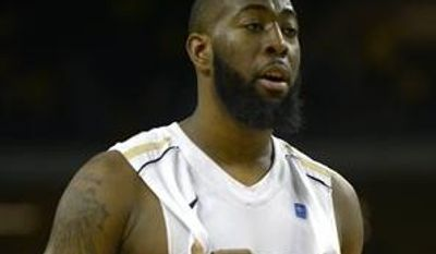 **FILE** Central Florida forward Keith Clanton (33) walks up the court during the second half of an NCAA college basketball game against Memphis in Orlando, Fla., Saturday, March 2, 2013. Memphis won 76-67.(AP Photo/Phelan M. Ebenhack)