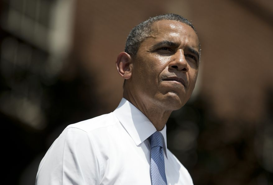 President Obama pauses during a speech on climate change at Georgetown University on June 25, 2013, in Washington. (Associated Press)