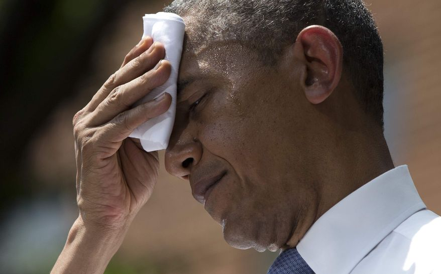 ** FILE ** President Obama wipes away sweat during a speech at Georgetown University on June 25, 2013. (Associated Press)