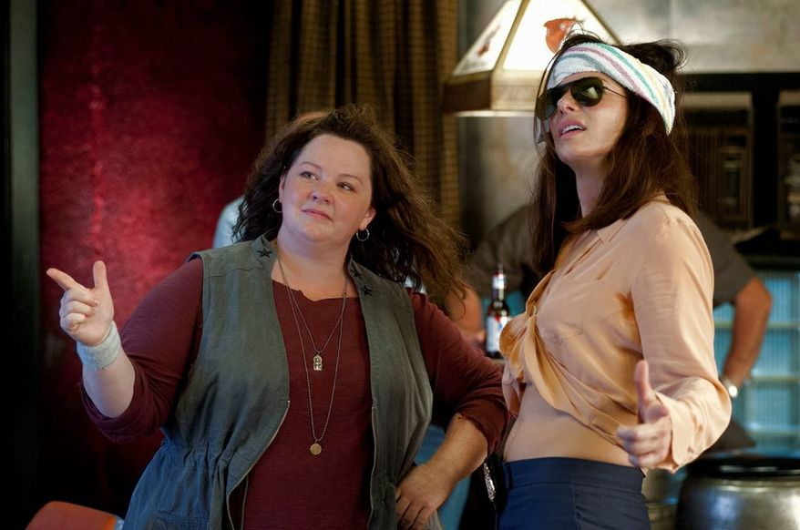 "Melissa McCarthy (left) and Sandra Bullock play a mismatched pair of law enforcement officers thrown together on a case in ""The Heat."" (20th Century Fox via Associated Press)"
