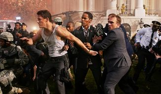"""White House Down,"" a low-brow shoot-'em-up thriller, stars Channing Tatum (left) as a nice-guy protection agent and Jamie Foxx (center) as the president of the United States. (Sony Pictures Entertainment via Associated Press)"