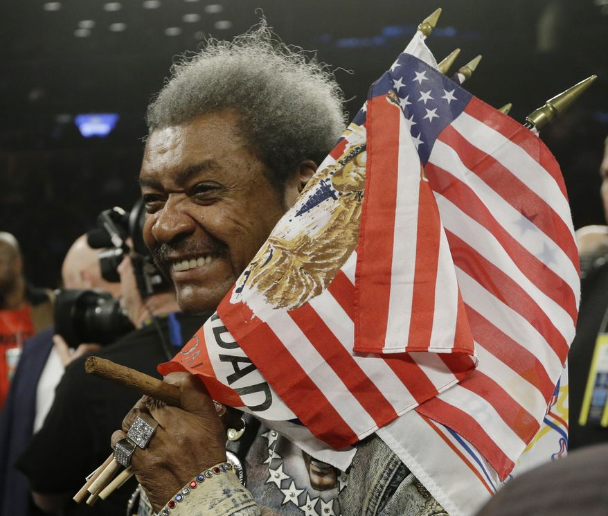 **FILE** Boxing promoter Don King, seen here after an IBF light heavyweight championship boxing match between Tavoris Cloud and Bernard Hopkins at the Barclays Center in New York on March 9, 2013, was convicted of second-degree murder in 1966 after he was found guilty of stomping an employee to death. The charge was later reduced to manslaughter and he was subsequently pardoned. (Associated Press)