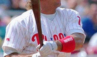 **FILE** Philadelphia Phillies Darren Daulton bats in this 1993 photo. (AP Photo/Chris Gardner)