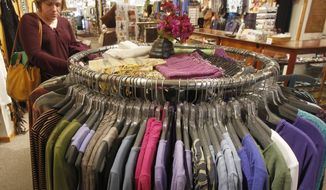 A shopper looks over clothing at the Vermont Trading Company in Montpelier, Vt., on Tuesday, April 9, 2013. (AP Photo/Toby Talbot)