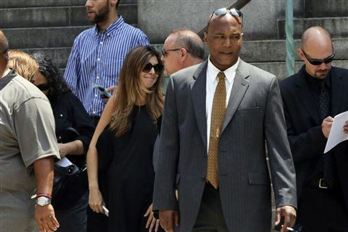 """Actress Jamie Lynn Sigler, center, leaves the Cathedral Church of Saint John the Divine after the funeral service for James Gandolfini, Thursday, June 27, 2013 in New York. Gandolfini, who played Tony Soprano in the HBO show """"The Sopranos"""", died while vacationing in Italy last week. (AP Photo/Mary Altaffer)"""