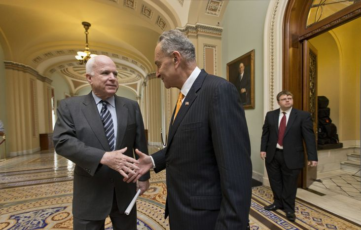 "** FILE ** Sens. John McCain (left), Arizona Republican, and Charles E. Schumer, New York Democrat, two of the authors of the immigration reform bill crafted by the Senate's bipartisan ""Gang of Eight,"" shake hands on Capitol Hill in Washington on Thursday, June 27, 2013, before the final vote. (Associated Press)"