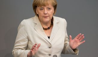** FILE ** German Chancellor Angela Merkel, June 27, 2013. (AP Photo/dpa, Tim Brakemeier)