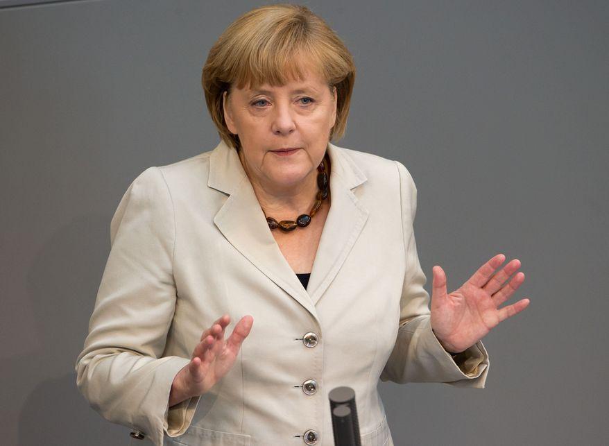 ** FILE ** German Chancellor Angela Merkel, June 27, 2013. (AP Photo/dpa, Tim Brakemeier)