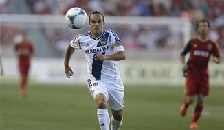 LA Galaxy's Landon Donovan breaks away as Real Salt Lake defenders trail behind in the first half during an MLS soccer game on Saturday, June 8, 2013, in Sandy, Utah. (AP Photo/Rick Bowmer)