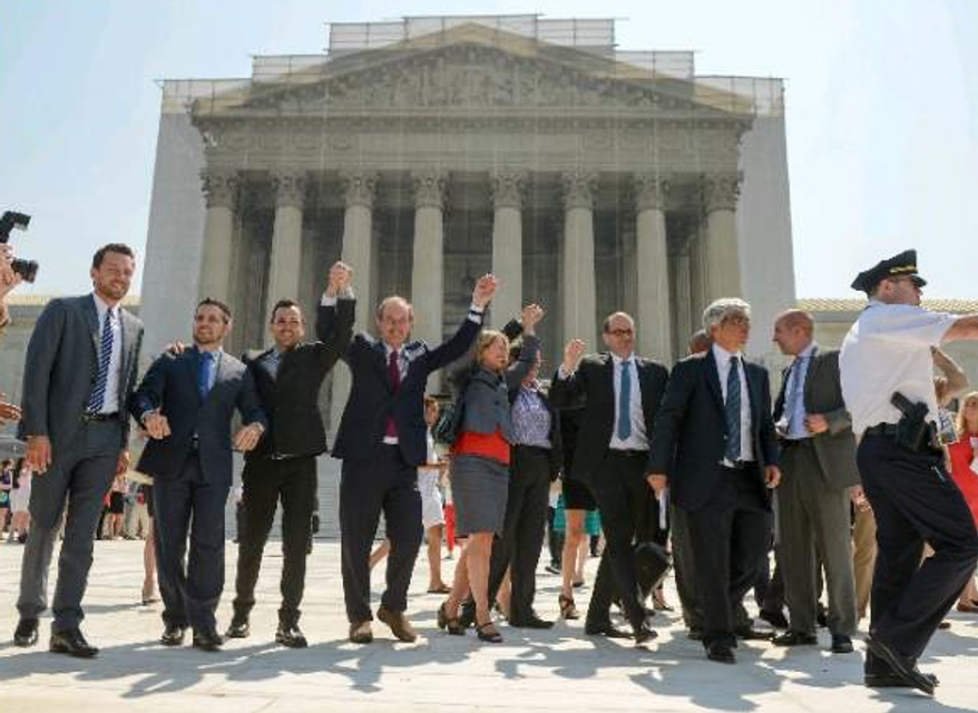 Plaintiffs and supporters for the California Proposition 8 case hail Supreme Court decisions that struck down a section of federal law denying benefits to married gay couples and cleared the way to resume same-sex marriage in California. (Andrew Harnik/The Washington Times)