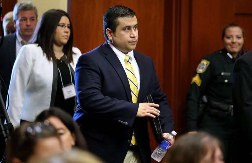 George Zimmerman (center) arrives for the 15th day of his trial in Seminole circuit court in Sanford, Fla., on June 28, 2013. Zimmerman has been charged with second-degree murder for the 2012 shooting death of Trayvon Martin. (Associated Press/Orlando Sentinel)