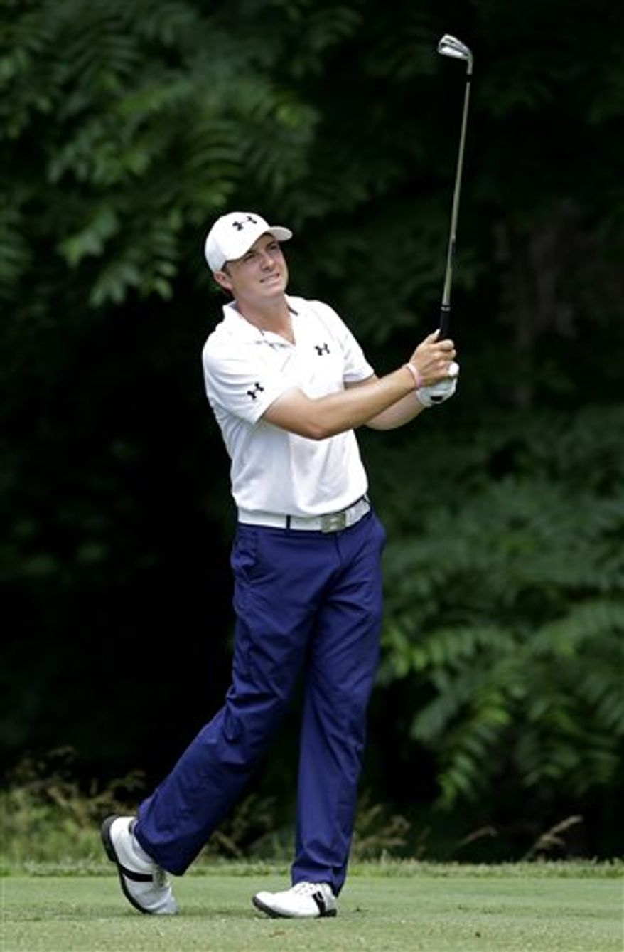 Jordan Spieth watches his tee shot from the 13th tee during the second round of the AT&T National golf tournament at Congressional Country Club, Friday, June 28, 2013, in Bethesda, Md. (AP Photo/Patrick Semansky)