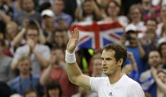 Andy Murray of Britain reacts after defeating Tommy Robredo of Spain during their Men's singles match at the All England Lawn Tennis Championships in Wimbledon, London, Friday, June 28, 2013. (AP Photo/Anja Niedringhaus)
