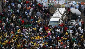Ruling party supporters, gather outside the Mediclinic Heart Hospital where former South African President Nelson Mandela is being treated in Pretoria, South Africa, Thursday, June 27, 2013. Nelson Mandela's health improved overnight and his condition remains critical but is now stable, the South African government said Thursday in a statement that brought a measure of relief to the country. (AP Photo/Themba Hadebe)