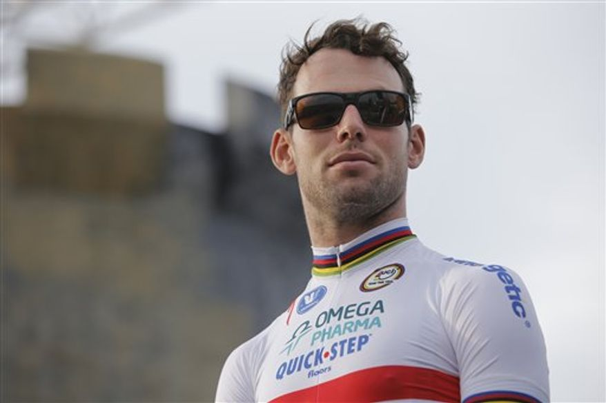 "British sprinter Mark Cavendish walks onto the stage during the official team presentation of the Tour de France cycling race in Porto Vecchio, southern Corsica island, France, Thursday June 27, 2013. The 28-year-old native of the Isle of Man, garnering him the ""Manx Missile"" moniker among fellow Britons and cycling buffs, is the best sprinter of his generation. Cavendish already has 23 Tour stage victories, putting him fourth on the all-time list. The race starts in Porto Vecchio on Saturday June 29, and the 198-rider peloton, or pack, is to cover 3,479 kilometers (2,162 miles) over three weeks, 21 stages and two rest days, before an unusual nighttime finish July 21 on the Champs-Elysees in Paris. (AP Photo/Laurent Cipriani)"