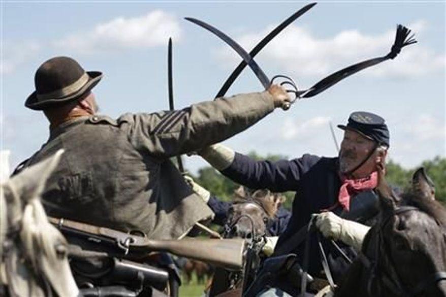 Reenactors demonstrate a cavalry battle during activities commemorating the 150th anniversary of the Battle of Gettysburg, June 29, 2013. (AP Photo/Matt Rourke) ** FILE **