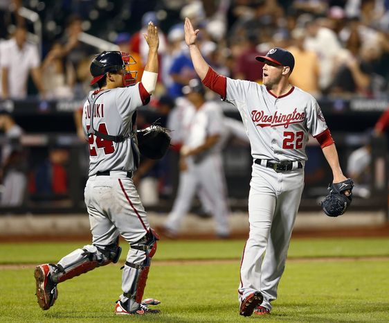 Right-hander Drew Storen, right, and catcher Kurt Suzuki celebrate the Nationals' 6-4 comeback victory over the New York Mets on Friday night. (Associated Press photo)