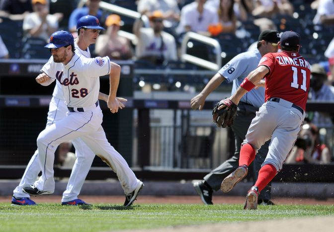 Ryan Zimmerman chases after an errant throw in the Nationals' 5-1 loss to the New York Mets. (Associated Press photo)