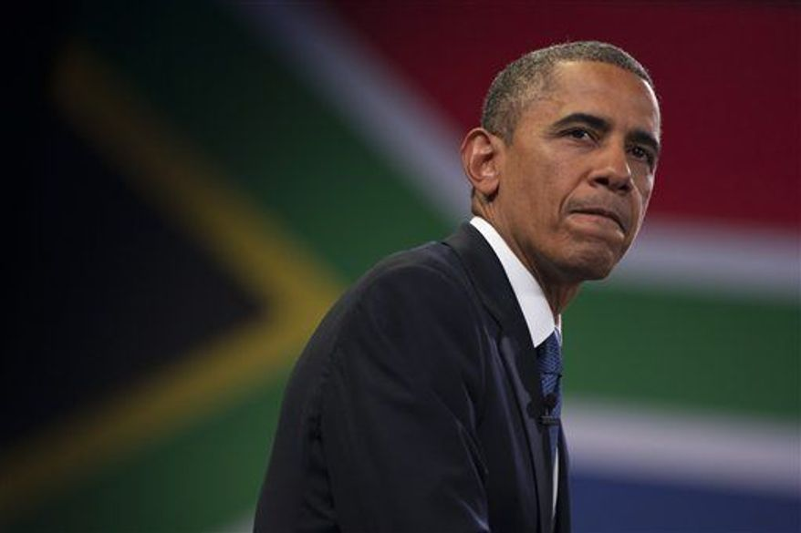 President Obama pauses during a town hall meeting with young African leaders at the University of Johannesburg Soweto on Saturday, June 29, 2013, in Johannesburg, South Africa. (AP Photo/Evan Vucci)