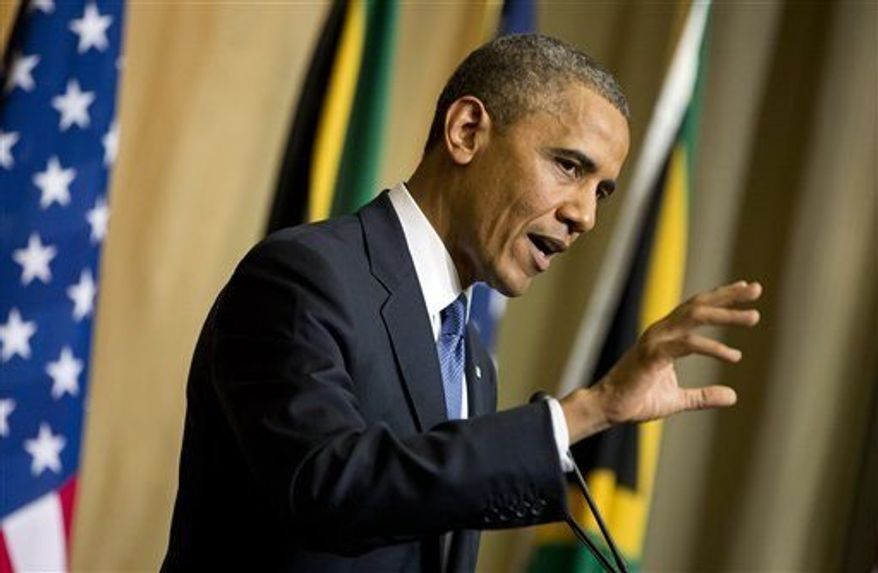 President Obama gestures during a news conference with South African President Jacob Zuma, not pictured, at the Union Building on Saturday, June 29, 2013, in Pretoria, South Africa. (AP Photo/Evan Vucci)