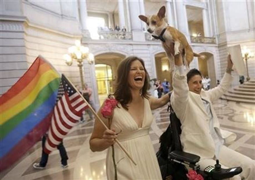 ** FILE ** Jen Rainin, left, laughs as her wife Frances holds up their dog Punum after they were married at City Hall in San Francisco, Friday, June 28, 2013. (AP Photo/Jeff Chiu)