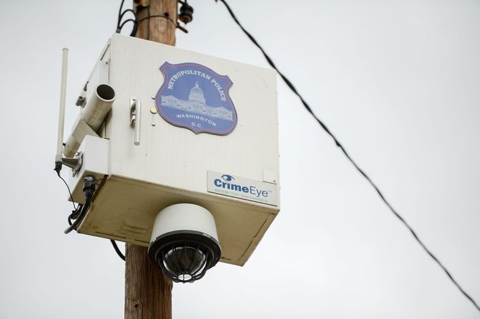 A Metropolitan Police Department camera sits high above home in the Berry Farms Neighborhood in Southeast. Police say they track criminal activity in areas to determine where the cameras are most useful. (Andrew Harnik/The Washington Times)