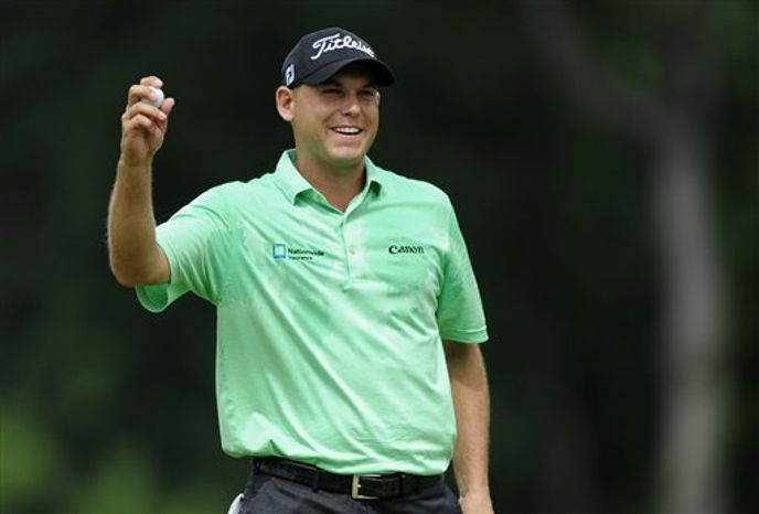 Bill Haas reacts after winning the AT&T National golf tournament at Congressional Country Club, Sunday, June 30, 2013, in Bethesda, Md. (AP Photo/Nick Wass)