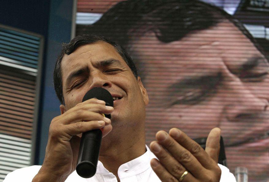 """** FILE ** Ecuadorean President Rafael Correa sings during his weekly live broadcast, """"Enlace Ciudadano,"""" or """"Citizen Link,"""" in Manta, Ecuador, on Saturday, June 29, 2013. (AP Photo/Martin Mejia)"""