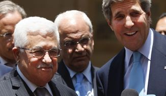** FILE ** U.S. Secretary of State John F. Kerry (right) and Palestinian President Mahmoud Abbas (left) brief the media after their meeting in the West Bank city of Ramallah on Sunday, June 30, 2013. (AP Photo/Majdi Mohammed)