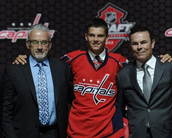 Andre Burakovsky, a winger, stands with coach Adam Oates, right, from the Washington Capitals after being chosen 23rd overall in the first round of the NHL hockey draft, Sunday, June 30, 2013, in Newark, N.J. (AP Photo/Bill Kostroun)