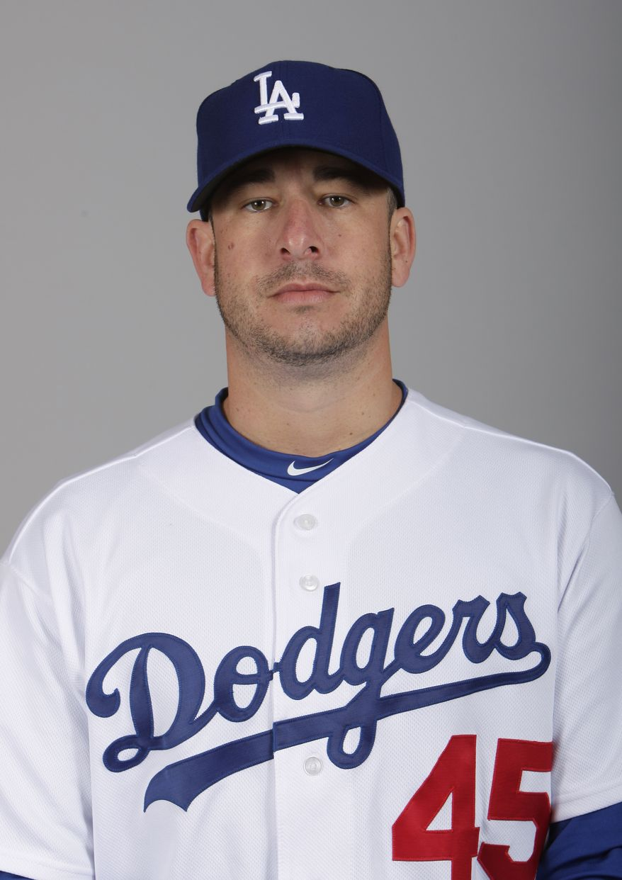 Justin Miller poses during photo day at the Los Angeles Dodgers' spring training facility in Glendale, Ariz., in 2010. (AP Photo/Mark Duncan)