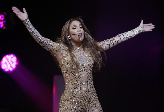** FILE ** Singer-actress Jennifer Lopez performs at the JW Marriott Desert Ridge Resort and Spa in Phoenix on Saturday, March 23, 2013. (Rick Scuteri/Invision/AP)