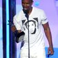 ** FILE ** Jamie Foxx accepts the award for best actor at the BET Awards on June 30, 2013, at the Nokia Theatre in Los Angeles. (Frank Micelotta/Invision/Associated Press)