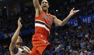 **FILE** Portland Trail Blazers guard Eric Maynor shoots in front of Oklahoma City Thunder guard Derek Fisher int he second quarter of an NBA basketball game in Oklahoma City, Sunday, March 24, 2013. (AP Photo/Sue Ogrocki)