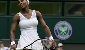 Serena Williams reacts during her match against Sabine Lisicki of Germany in a Women's singles at the All England Lawn Tennis Championships in Wimbledon, London, on July 1, 2013. (Associated Press)