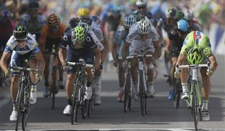 Australia's Simon Gerrans, left, crosses the finish line ahead of Peter Sagan of Slovakia, right and second place, Jose Joaquin Rojas of Spain, second left, and third place, and Belgium's Philippe Gilbert, second right and fifth place, to win the third stage of the Tour de France cycling race over 145.5 kilometers (91 miles) with start in Ajaccio and finish in Calvi, Corsica island, France, Monday July 1, 2013. (AP Photo/Laurent Rebours)