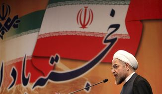 **FILE** Iranian President-elect Hasan Rouhani speaks in a conference in Tehran on June 29, 2013. (Associated Press/Office of the President-elect)