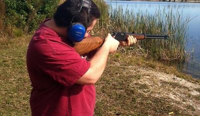 Sam Parvin shooting a rifle. (Courtesy Daniel Parvin)