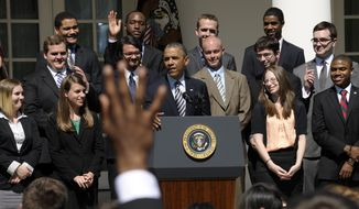 President Obama listens to the audience's response to a question he asked during a Rose Garden event with college students on Friday, May 31, 2013, at the White House, during which the president called on Congress to keep federally subsidized student loans rates from doubling on July 1. (AP Photo/Susan Walsh)