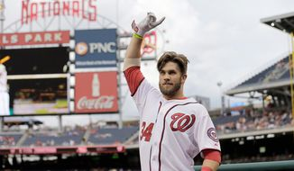 Washington Nationals left fielder Bryce Harper, 20, acknowledges the hometown fans after hitting a home run Monday in his first at-bat following a 31-game stint on the disabled list. (Associated Press)