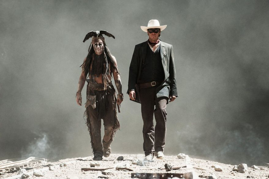 "Johnny Depp, left, as Tonto, and Armie Hammer, as the Lone Ranger, in a scene from the film, ""The Lone Ranger.""  (AP Photo/Disney/Jerry Bruckheimer, Inc., Peter Mountain, File)"