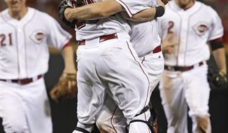Cincinnati Reds starting pitcher Homer Bailey, right, hugs catcher Ryan Hanigan, left, after Bailey threw a no-hitter against the San Francisco Giants in a baseball game, Tuesday, July 2, 2013, in Cincinnati. Cincinnati won 3-0. (AP Photo/Al Behrman)