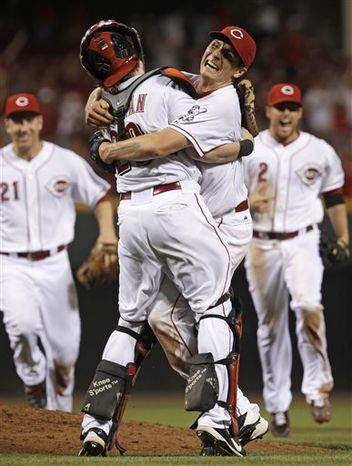 Cincinnati Reds starting pitcher Homer Bailey, right, hugs catcher Ryan Hanigan, left, after Bailey threw a no-hitter against the San Francisco Giants in a baseball game, Tuesday, July 2, 2013, in Cincinnati. Cincinnati won 3-0. (AP Photo/Al Behrman)