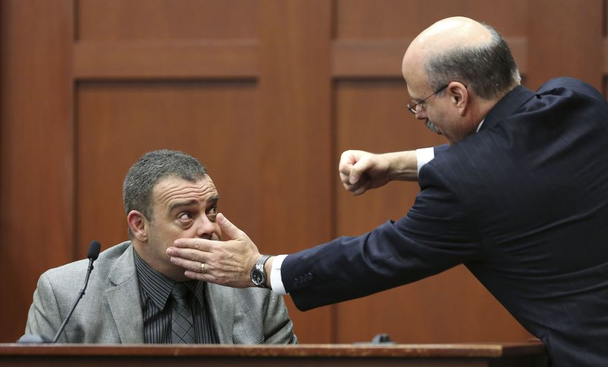 Prosecutor Bernie de la Rionda (right) demonstrates a possible scenario while questioning state's witness Chris Serino, a Sanford police officer, during the George Zimmerman trial in Seminole circuit court in Sanford, Fla., on July 2, 2013. Zimmerman has been charged with second-degree murder for the 2012 shooting death of Trayvon Martin. (Associated Press/Orlando Sentinel)