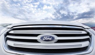 The grill of a new 2013 Ford Taurus FWD Limited is seen at a dealership in Zelienople, Pa., on Wednesday, May 8, 2013. (AP Photo/Keith Srakocic)