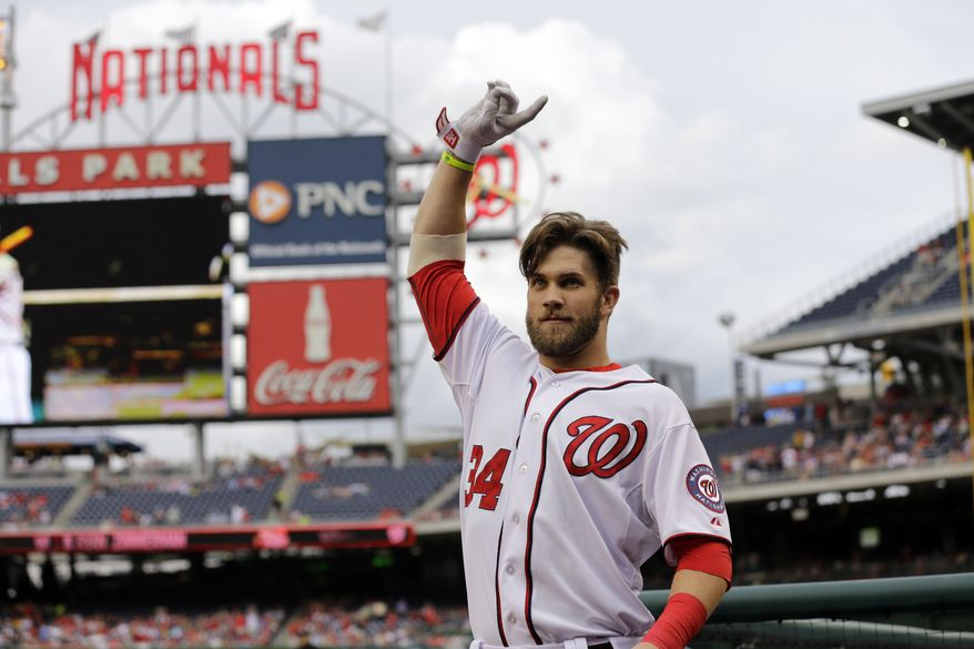 Bryce Harper takes a curtain call at Nationals Park after homering in his first at-bat back following a 31-game stay on the disabled list. The Nationals beat the Brewers 10-5. (Associated Press photo)