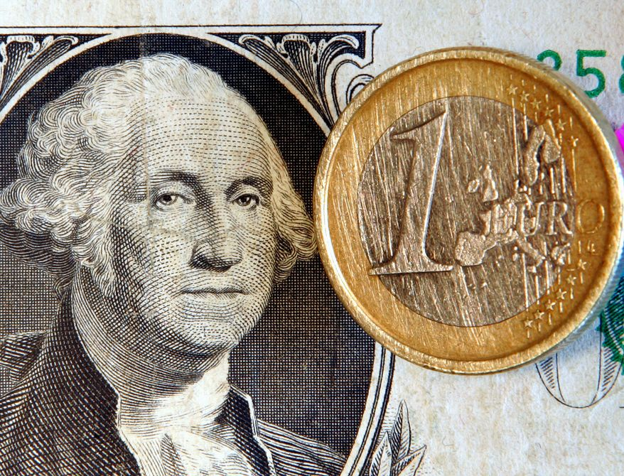 A $1 bill and a 1-euro coin (AP Photo/Michael Probst)