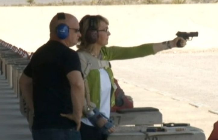 In this screen capture of a video from ABC News, former Arizona Rep. Gabrielle Giffords fires a pistol at a Las Vegas shooting range. It was the first time she has shot a gun since being shot in the head in 2011 during a gunman's rampage. With her is her husband, astronaut Mark Kelly.
